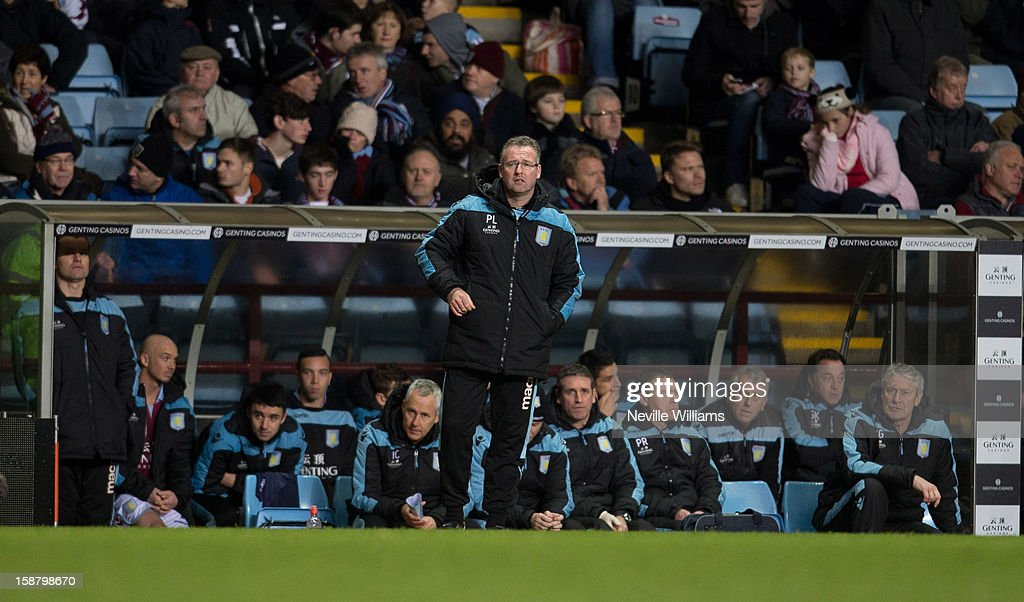 Paul Lambert manager of Aston Villa stands in front of the bench during the Barclays Premier League match between Aston Villa and Wigan Athletic at Villa Park on December 29, 2012 in Birmingham, England.