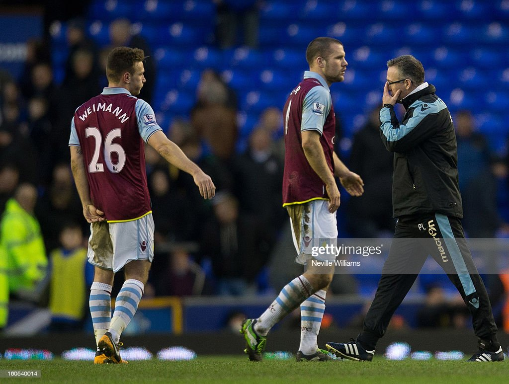 Paul Lambert (L), manager of Aston Villa, walks off at the end of the Barclays Premier League match between Everton and Aston Villa at Goodison Park on February 02, 2013 in Liverpool, England.