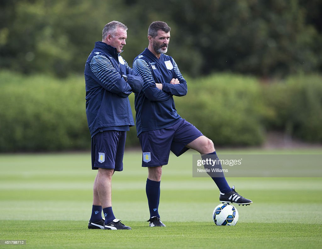 Paul Lambert manager of Aston Villa watches on with assistant manager <a gi-track='captionPersonalityLinkClicked' href=/galleries/search?phrase=Roy+Keane&family=editorial&specificpeople=171835 ng-click='$event.stopPropagation()'>Roy Keane</a> during a Aston Villa training session at the club's training ground at Bodymoor Heath on July 07, 2014 in Birmingham, England.