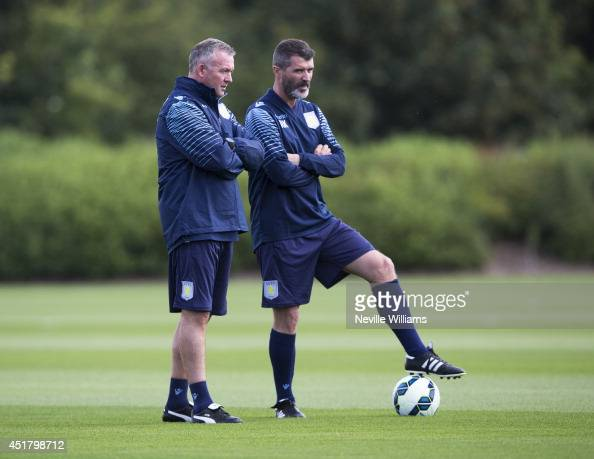 Paul Lambert manager of Aston Villa watches on with assistant manager Roy Keane during a Aston Villa training session at the club's training ground...