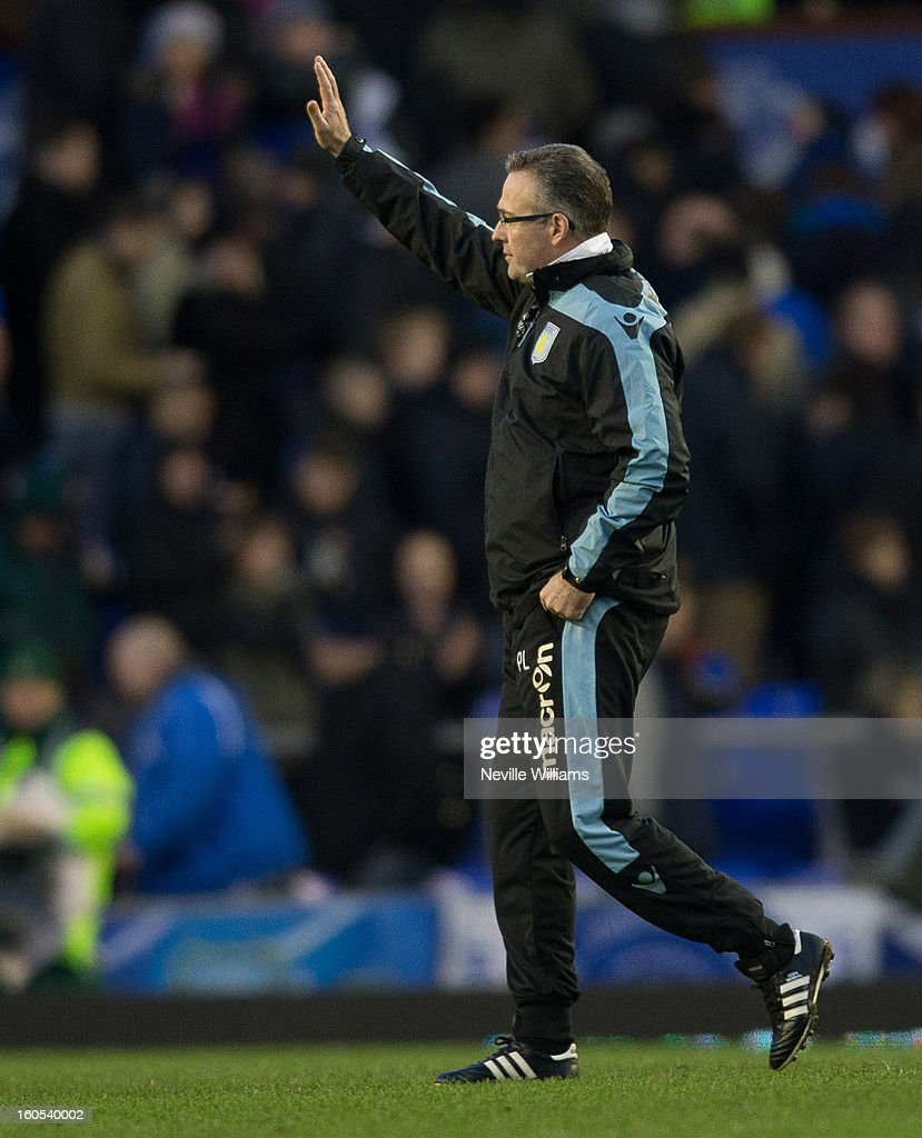 Paul Lambert, manager of Aston Villa, waves to fans at the end of the Barclays Premier League match between Everton and Aston Villa at Goodison Park on February 02, 2013 in Liverpool, England.