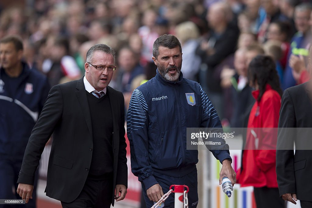 Paul Lambert manager of Aston Villa with his assistant Roy Keane during the Barclays Premier League match between Stoke City and Aston Villa at the Britannia Stadium on August 16, 2014 in Stoke on Trent, England.