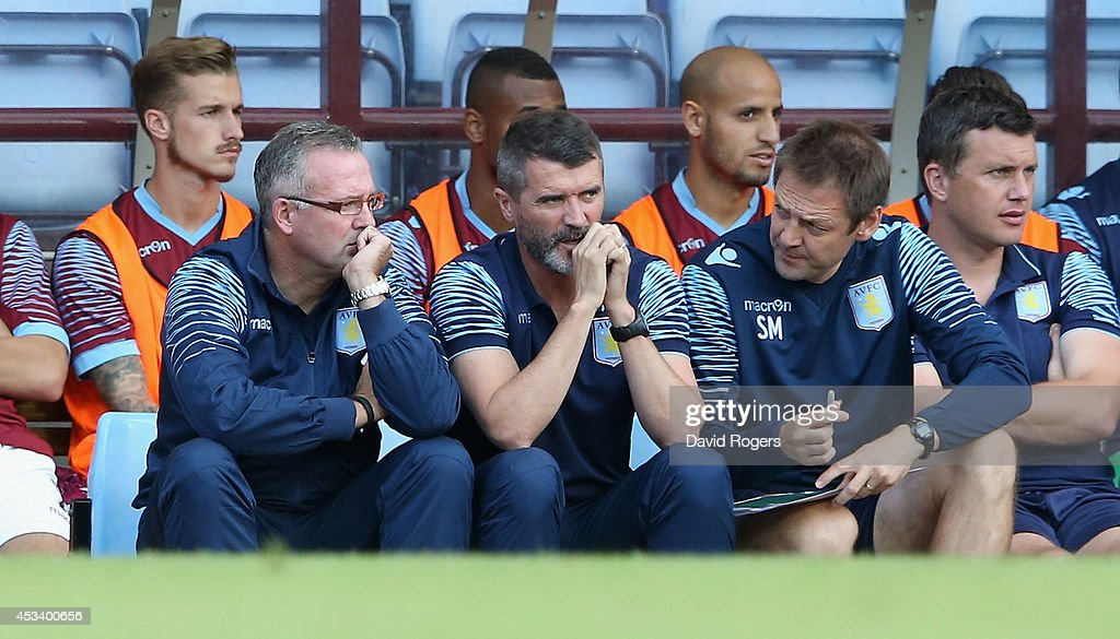 Paul Lambert (L) the Aston Villa manager looks on with his assistant Roy Keane during the pre season friendly match between Aston Villa and Parma at Villa Park on August 9, 2014 in Birmingham, England.
