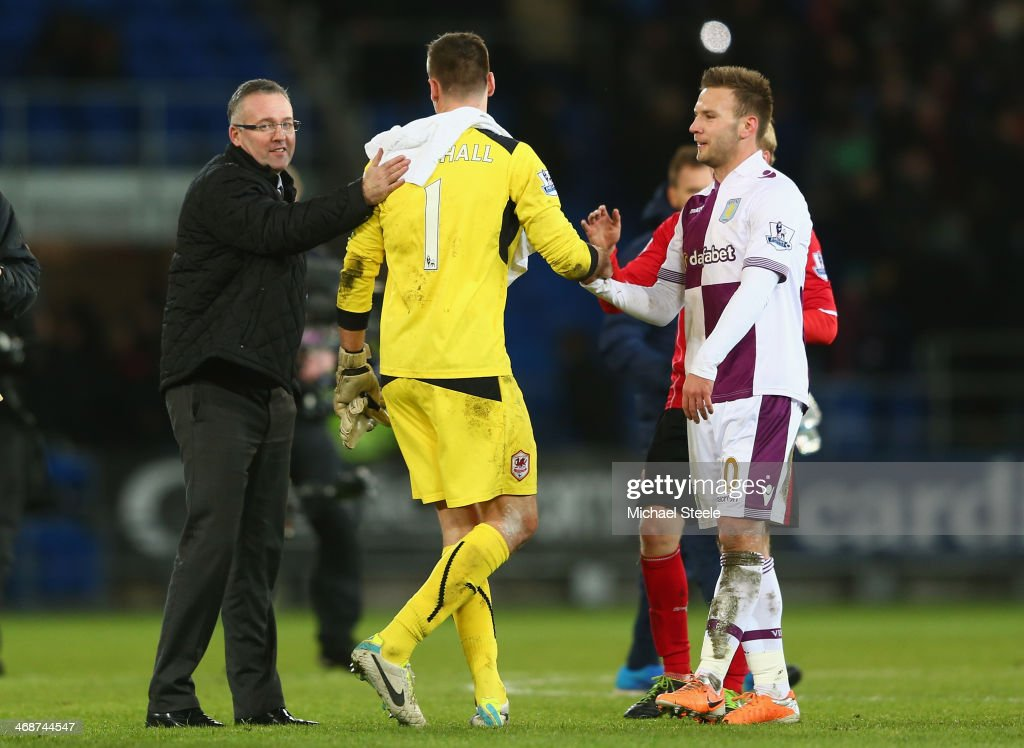 Paul Lambert (L) the manager of Aston Villa pats <a gi-track='captionPersonalityLinkClicked' href=/galleries/search?phrase=David+Marshall&family=editorial&specificpeople=4668874 ng-click='$event.stopPropagation()'>David Marshall</a> (C) the goalkeeper of Cardiff City on the back after a superb last minute save from <a gi-track='captionPersonalityLinkClicked' href=/galleries/search?phrase=Andreas+Weimann&family=editorial&specificpeople=5891558 ng-click='$event.stopPropagation()'>Andreas Weimann</a> (R) during the Barclays Premier League match between Cardiff City and Aston Villa at the Cardiff City Stadium on February 11, 2014 in Cardiff, Wales.