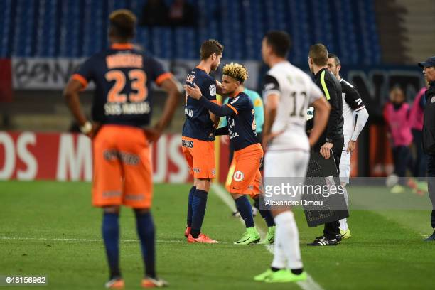 Paul Lasne and Keagan Dolly of Montpellier during the French Ligue 1 match between Montpellier and Guingamp at Stade de la Mosson on March 4 2017 in...