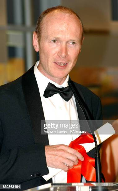 Paul Laverty after receiving the Best Screenplay award for Sweet Sixteen at the Palais des Festival at the end of the 55th Cannes Film Festival