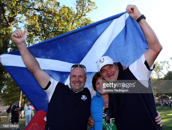 Paul Lawrie of Europe celebrates with his wife Marian and caddie David Kenny after Europe defeated the USA 145 to 135 to retain the Ryder Cup during...