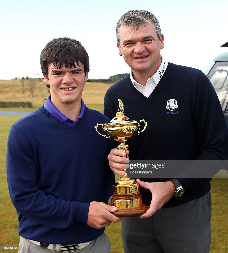 <a gi-track='captionPersonalityLinkClicked' href=/galleries/search?phrase=Paul+Lawrie&family=editorial&specificpeople=202995 ng-click='$event.stopPropagation()'>Paul Lawrie</a> of Scotland and his son Craig Lawrie fly in to the grounds of the Gleneagles Hotel during the offical handover of the Ryder Cup to The Gleneagles Hotel, the hosts of the 2014 event, at Gleneagles on October 3, 2012 in Auchterarder, Scotland.