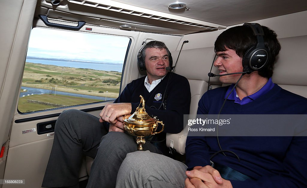 Paul Lawrie of Scotland and his son Craig Lawrie fly in to the grounds of the Gleneagles Hotel during the offical handover of the Ryder Cup to The Gleneagles Hotel, the hosts of the 2014 event, at Gleneagles on October 3, 2012 in Auchterarder, Scotland.
