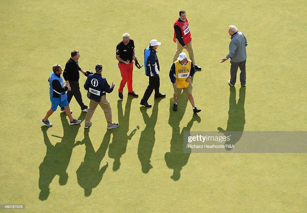 Paul Lawrie of Scotland, <a gi-track='captionPersonalityLinkClicked' href=/galleries/search?phrase=Arnold+Palmer&family=editorial&specificpeople=93096 ng-click='$event.stopPropagation()'>Arnold Palmer</a> of the United States, <a gi-track='captionPersonalityLinkClicked' href=/galleries/search?phrase=Darren+Clarke&family=editorial&specificpeople=171309 ng-click='$event.stopPropagation()'>Darren Clarke</a> of Northern Ireland and Bill Rogers of the United States gather with their caddies on the 18th green during the Champion Golfers' Challenge ahead of the 144th Open Championship at The Old Course on July 15, 2015 in St Andrews, Scotland.