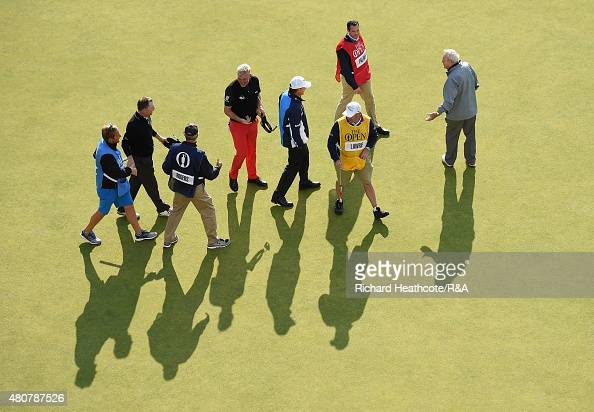 Paul Lawrie of Scotland Arnold Palmer of the United States Darren Clarke of Northern Ireland and Bill Rogers of the United States gather with their...