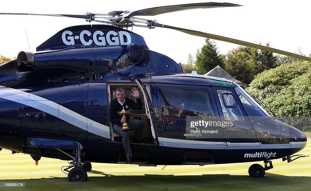 <a gi-track='captionPersonalityLinkClicked' href=/galleries/search?phrase=Paul+Lawrie&family=editorial&specificpeople=202995 ng-click='$event.stopPropagation()'>Paul Lawrie</a> of Scotland flys in to the grounds of the Gleneagles Hotel during the offical handover of the Ryder Cup to The Gleneagles Hotel, the hosts of the 2014 event, at Gleneagles on October 3, 2012 in Auchterarder, Scotland.