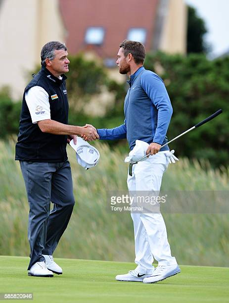 Paul Lawrie of Scotland is congratulated after winning his match against Lucas Bjerregaard of Denmark on day one of the Aberdeen Asset Management...