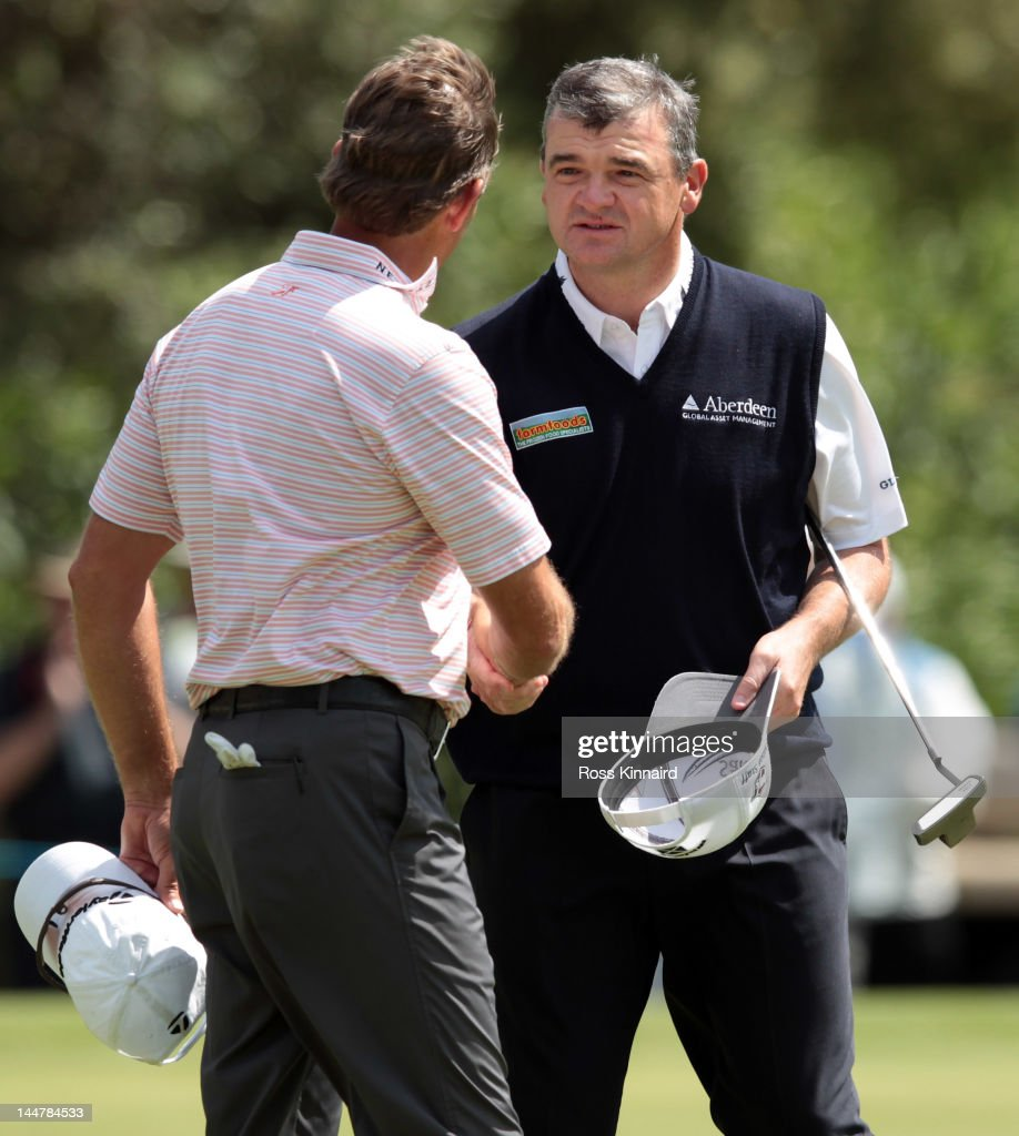Paul Lawrie of Scotland is congratulated by Retief Goosen of South Africa after the quarter final matches on day three of the Volvo World Match Play...