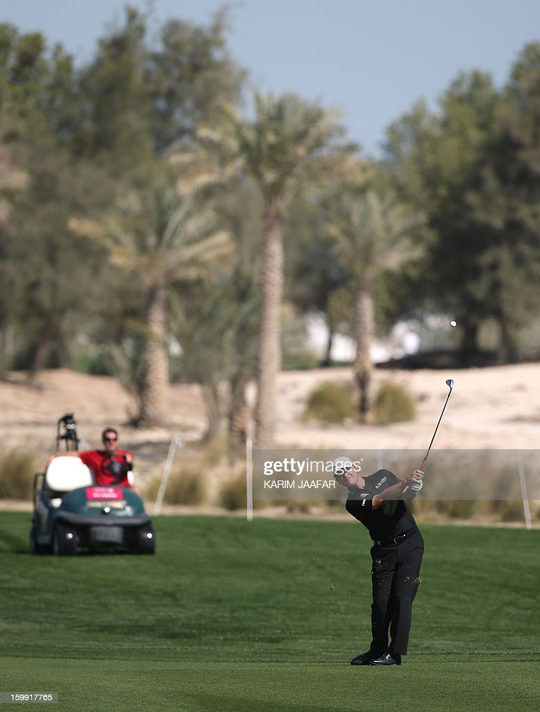 Paul Lawrie of Scotland is seen in action during the first round of the Qatar Masters Golf tournament in Doha on January 23, 2013.