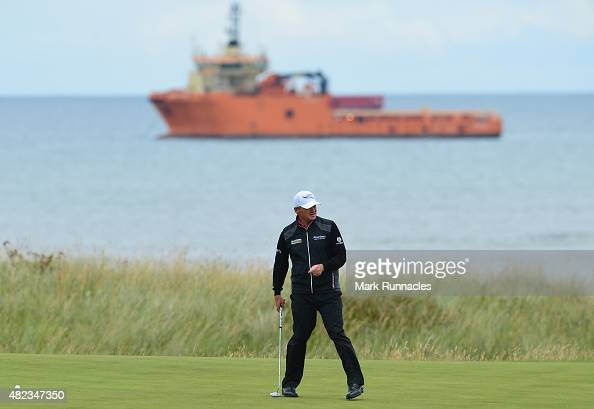 Paul Lawrie of Scotland looks for the line of a putt on the 4th green during the first day of the Saltire Energy Paul Lawrie Matchplay at Murcar...