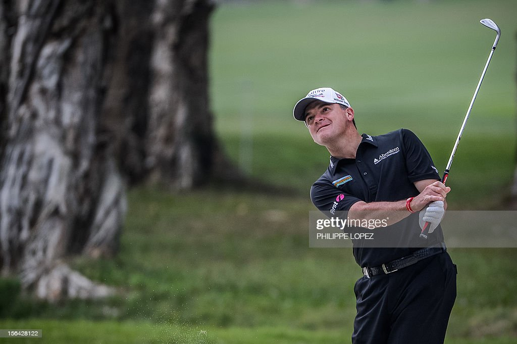Paul Lawrie of Scotland looks on after hitting a ball during the first day of the UBS Hong Kong Open at the Hong Kong Golf Club on November 15, 2012. AFP PHOTO / Philippe Lopez