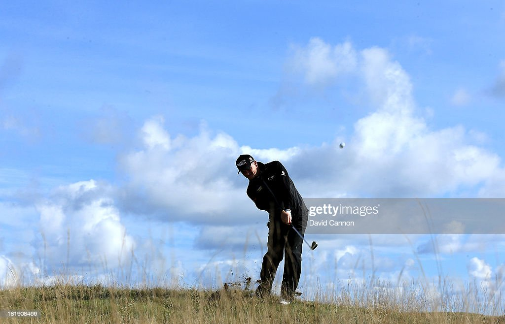 <a gi-track='captionPersonalityLinkClicked' href=/galleries/search?phrase=Paul+Lawrie&family=editorial&specificpeople=202995 ng-click='$event.stopPropagation()'>Paul Lawrie</a> of Scotland plays his second shot at the par 4, fourth hole during the first round of the 2013 Alfred Dunhill Links Championship on the Championship Course at Carnoustie on September 26, 2013 in Carnoustie, Scotland.