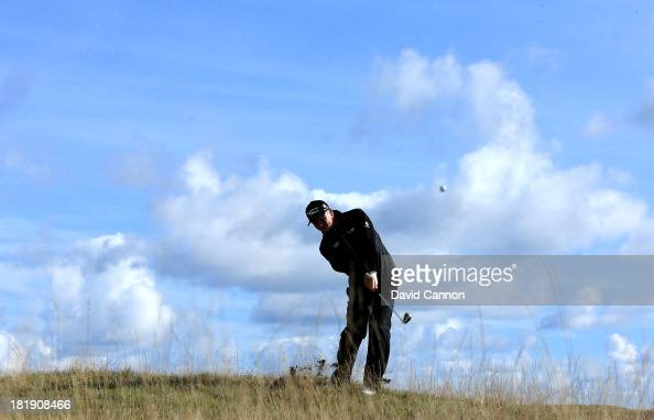 Paul Lawrie of Scotland plays his second shot at the par 4 fourth hole during the first round of the 2013 Alfred Dunhill Links Championship on the...