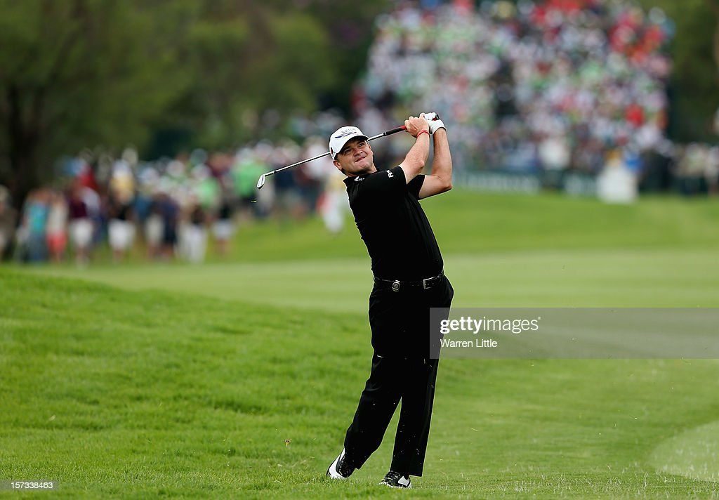 Paul Lawrie of Scotland plays his second shot into the first green during the final round of the Nedbank Golf Challenge at the Gary Player Country Club on December 2, 2012 in Sun City, South Africa.