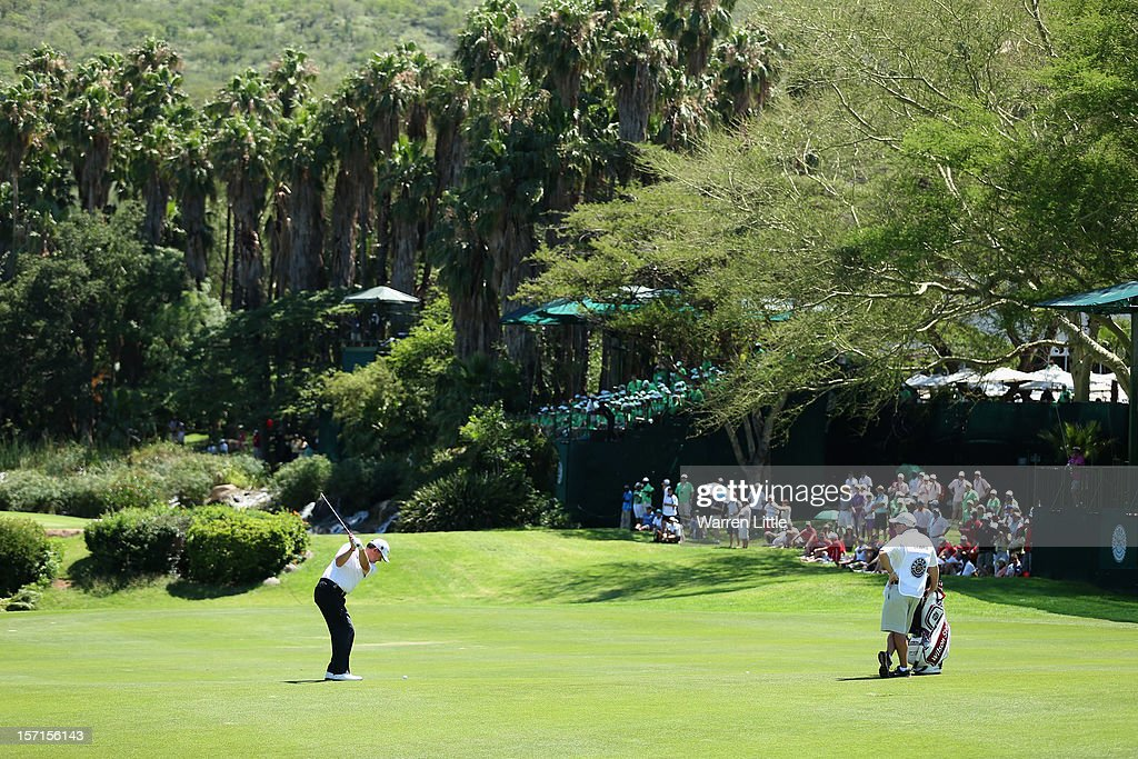 Paul Lawrie of Scotland plays his second shot into the ninth green during the first round of the Nedbank Golf Challenge at the Gary Player Country Club on November 29, 2012 in Sun City, South Africa.