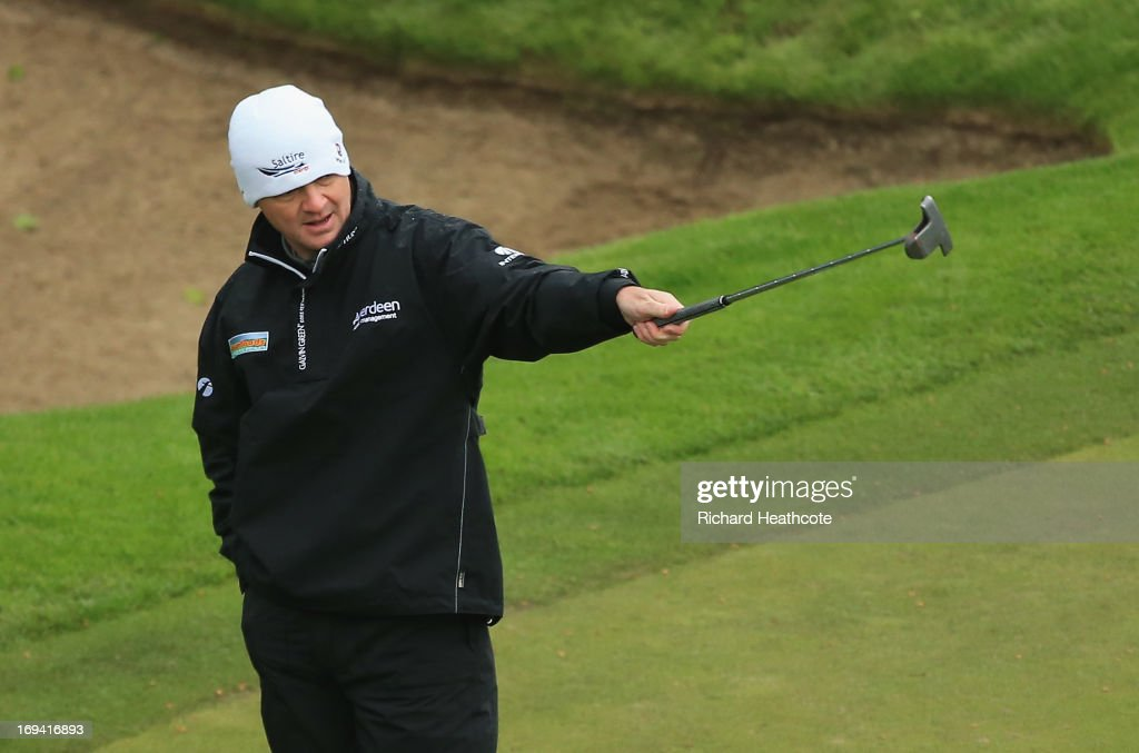 <a gi-track='captionPersonalityLinkClicked' href=/galleries/search?phrase=Paul+Lawrie&family=editorial&specificpeople=202995 ng-click='$event.stopPropagation()'>Paul Lawrie</a> of Scotland reacts to a missed putt on the 18th green during the second round of the BMW PGA Championship on the West Course at Wentworth on May 24, 2013 in Virginia Water, England.