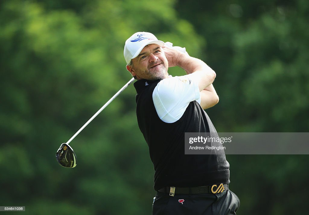 <a gi-track='captionPersonalityLinkClicked' href=/galleries/search?phrase=Paul+Lawrie&family=editorial&specificpeople=202995 ng-click='$event.stopPropagation()'>Paul Lawrie</a> of Scotland tees off on the 3rd hole during day two of the BMW PGA Championship at Wentworth on May 27, 2016 in Virginia Water, England.