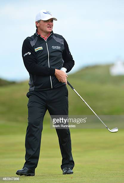 Paul Lawrie of Scotland watches his approach shot to the 3rd green during the first day of the Saltire Energy Paul Lawrie Matchplay at Murcar Links...