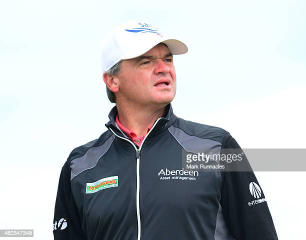Paul Lawrie of Scotland watches his drive from the first tee during the first day of the Saltire Energy Paul Lawrie Matchplay at Murcar Links Golf...