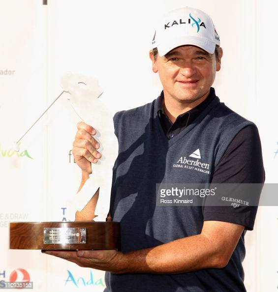 Paul Lawrie of Scotland with the winners trophy after the final round of the Open de Andalucia at the Parador de Malaga Golf Course on March 27 2011...