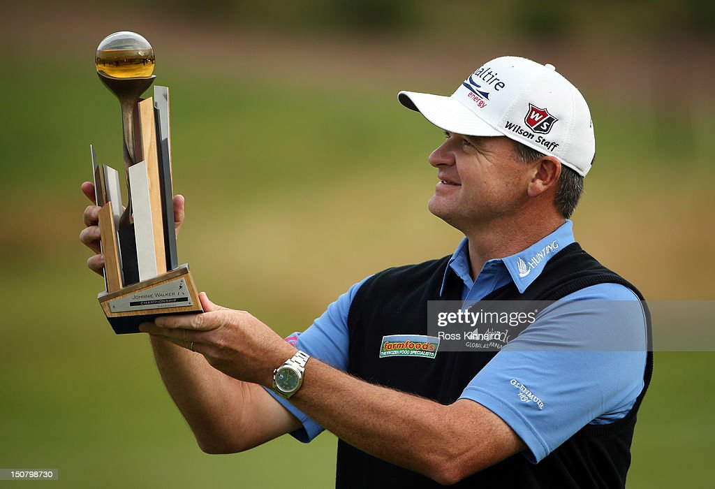 <a gi-track='captionPersonalityLinkClicked' href=/galleries/search?phrase=Paul+Lawrie&family=editorial&specificpeople=202995 ng-click='$event.stopPropagation()'>Paul Lawrie</a> of Scotland with the winners trophy during the final round of the Johnnie Walker Championship on the PGA Centenary Course at Gleneagles on August 26, 2012 in Auchterarder, Scotland.