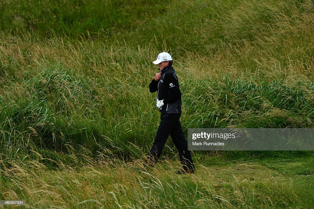 Paul Lawrie of Scotland zips up his coat as he walks to the 4th tee during the first day of the Saltire Energy Paul Lawrie Matchplay at Murcar Links...