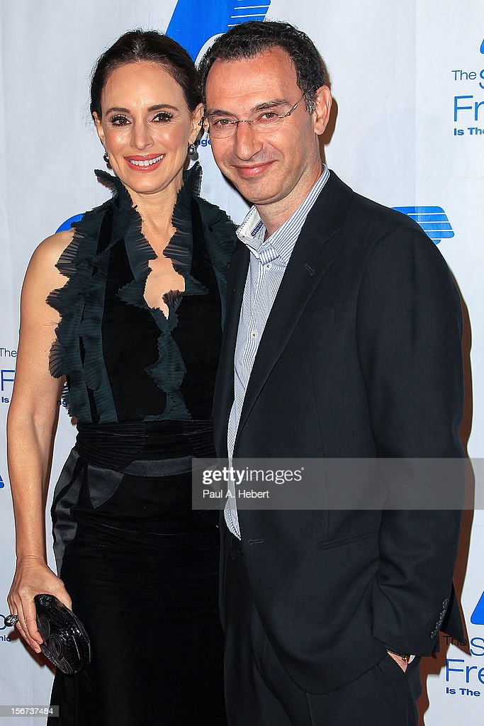 Paul Lee (R), President, ABC Entertainment Group, and actress <a gi-track='captionPersonalityLinkClicked' href=/galleries/search?phrase=Madeleine+Stowe&family=editorial&specificpeople=1018262 ng-click='$event.stopPropagation()'>Madeleine Stowe</a> arrive at The Saban Free Clinic's Gala Honoring ABC Entertainment Group President Paul Lee and Bob Broder at The Beverly Hilton Hotel on November 19, 2012 in Beverly Hills, California.