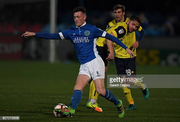 Paul Lewis of Macclesfield Town is tackled by Alex MacDonald of Oxford during The Emirates FA Cup Second Round match between Macclesfield Town and...