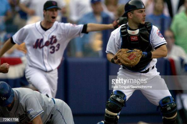 Paul Lo Duca of the New York Mets tags out Jeff Kent of the Los Angeles Dodgers at the plate then gets direction from pitcher John Maine to look out...