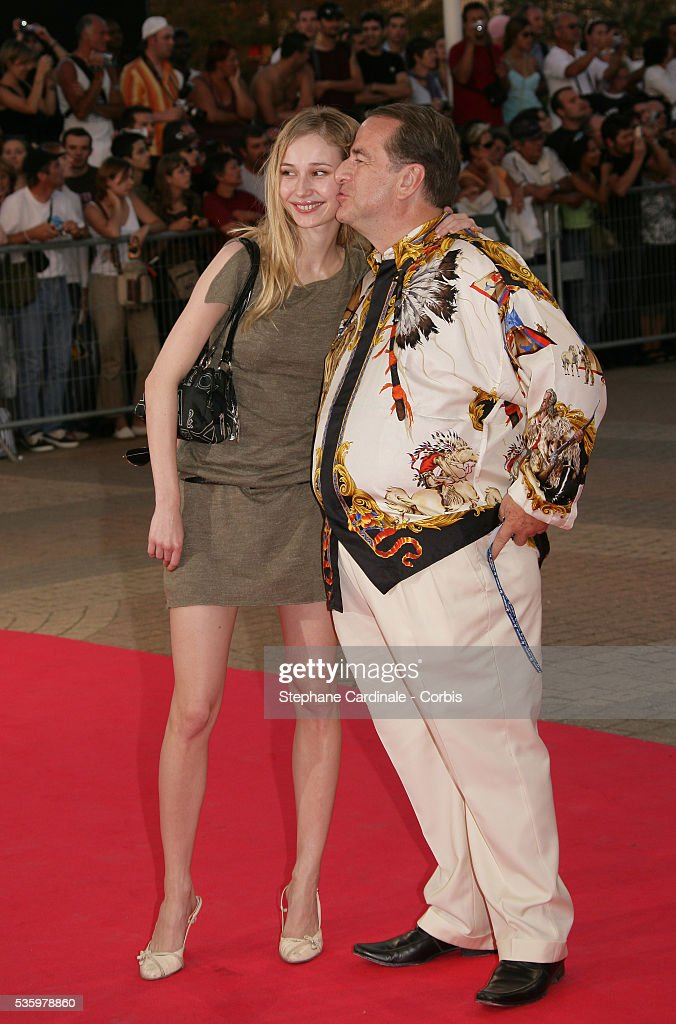 Paul Lou Sulitzer with his girlfriend Eva arrive at the premiere of 'The Ice Harvest' during the 31st American Deauville Film Festival.