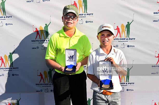 R Paul Lucas and Cooper Jones pose with their medals after tying for first in the Putting competition in the Boys 1011 yr old division during the...