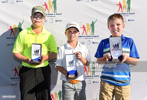 R Paul Lucas Cooper Jones and Preston Slama pose with their medals after tying for first and placing third in the Putting competition in the Boys...