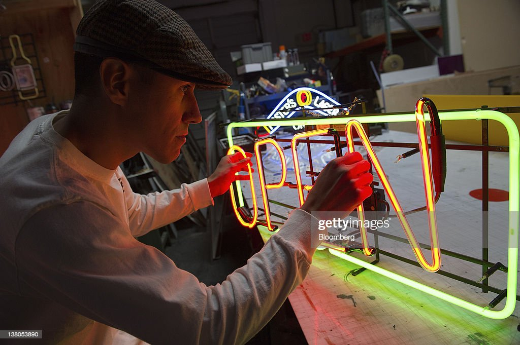 Paul Macias, owner of Paul's Neon Signs, assembles a neon sign at his shop in Las Vegas, Nevada, U.S., on Friday, Jan. 27, 2012. The Nevada Republican presidential caucus will be held on Feb. 4. Photographer: David Paul Morris/Bloomberg via Getty Images