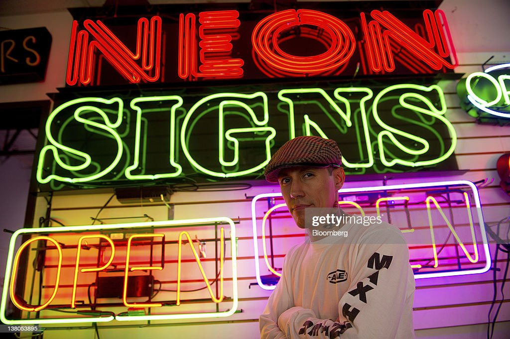 Paul Macias, owner of Paul's Neon Signs, stands for a photograph at his shop in Las Vegas, Nevada, U.S., on Friday, Jan. 27, 2012. The Nevada Republican presidential caucus will be held on Feb. 4. Photographer: David Paul Morris/Bloomberg via Getty Images