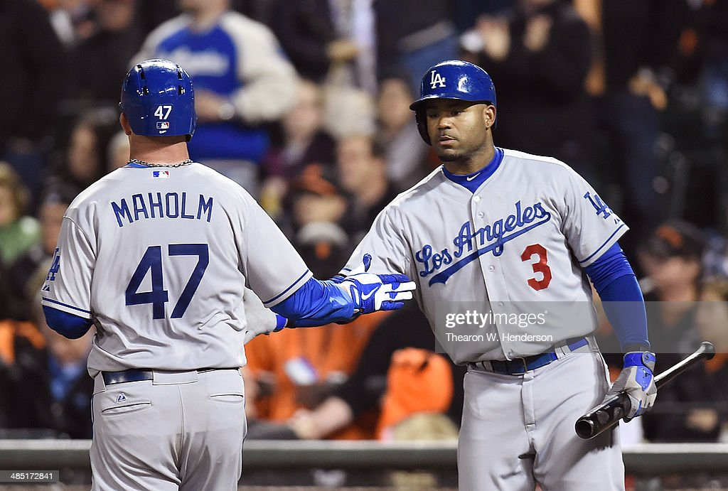 <a gi-track='captionPersonalityLinkClicked' href=/galleries/search?phrase=Paul+Maholm&family=editorial&specificpeople=585406 ng-click='$event.stopPropagation()'>Paul Maholm</a> #47 of the Los Angeles Dodgers is congratulated by <a gi-track='captionPersonalityLinkClicked' href=/galleries/search?phrase=Carl+Crawford&family=editorial&specificpeople=208074 ng-click='$event.stopPropagation()'>Carl Crawford</a> #3 after Maholm scored against the San Francisco Giants in the top of the sixth inning at AT&T Park on April 16, 2014 in San Francisco, California. Maholm scored on a triple from Dee Gordon.
