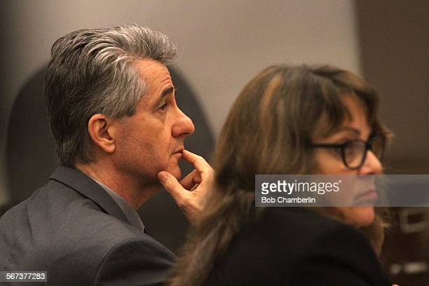 Paul Marshal Curry listens to opening statements in his murder trial with his attorney deputy public defender Lisa Kopelman at Orange County Superior...