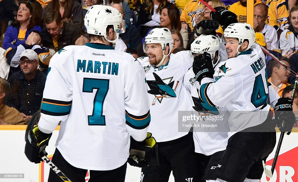 <a gi-track='captionPersonalityLinkClicked' href=/galleries/search?phrase=Paul+Martin+-+Ice+Hockey+Player&family=editorial&specificpeople=4006879 ng-click='$event.stopPropagation()'>Paul Martin</a> #7, <a gi-track='captionPersonalityLinkClicked' href=/galleries/search?phrase=Joonas+Donskoi&family=editorial&specificpeople=7029359 ng-click='$event.stopPropagation()'>Joonas Donskoi</a> #27, <a gi-track='captionPersonalityLinkClicked' href=/galleries/search?phrase=Joel+Ward+-+Ice+Hockey+Player&family=editorial&specificpeople=7231959 ng-click='$event.stopPropagation()'>Joel Ward</a> #42, and <a gi-track='captionPersonalityLinkClicked' href=/galleries/search?phrase=Tomas+Hertl&family=editorial&specificpeople=8761287 ng-click='$event.stopPropagation()'>Tomas Hertl</a> #48 celebrate after the game tying goal against of the Nashville Predators during the second period of Game Four of the Western Conference Second Round during the 2016 NHL Stanley Cup Playoffs at Bridgestone Arena on May 5, 2016 in Nashville, Tennessee.