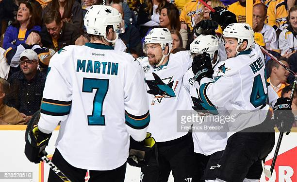 Paul Martin Joonas Donskoi Joel Ward and Tomas Hertl celebrate after the game tying goal against of the Nashville Predators during the second period...