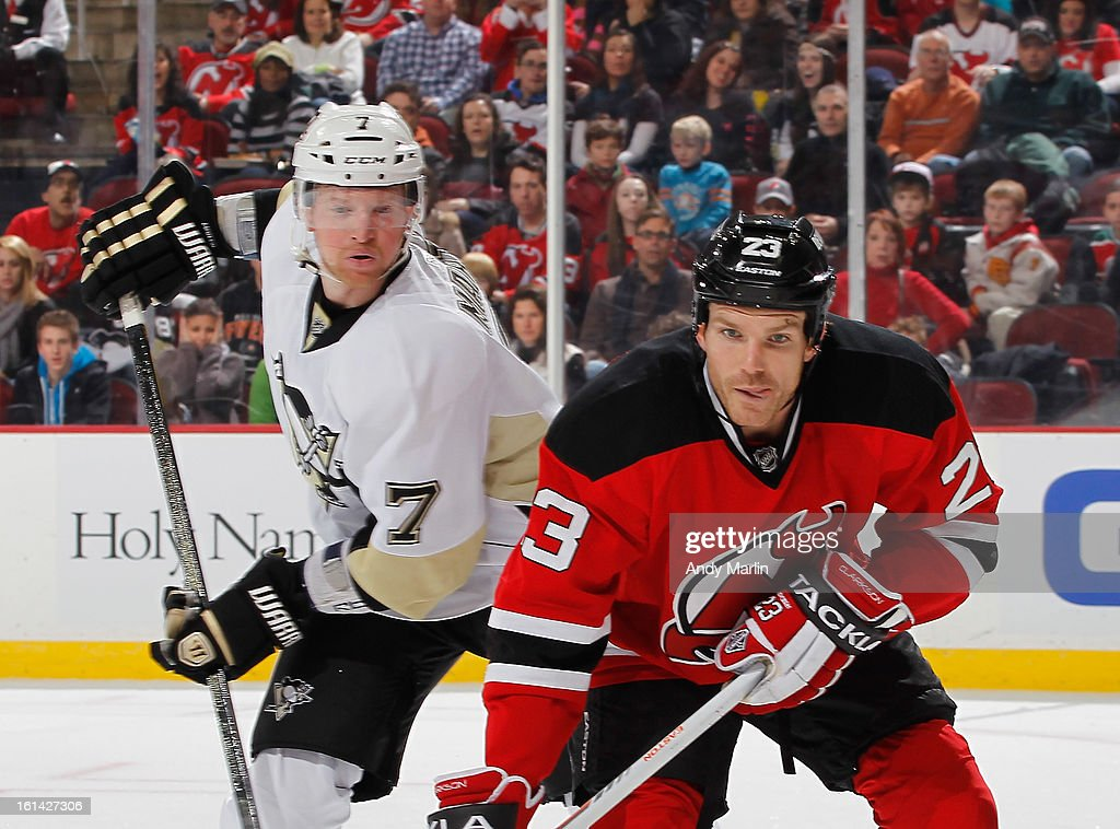 Paul Martin #7 of the Pittsburgh Penguins and David Clarkson #23 of the New Jersey Devils skate for position during the game at the Prudential Center on February 9, 2013 in Newark, New Jersey.