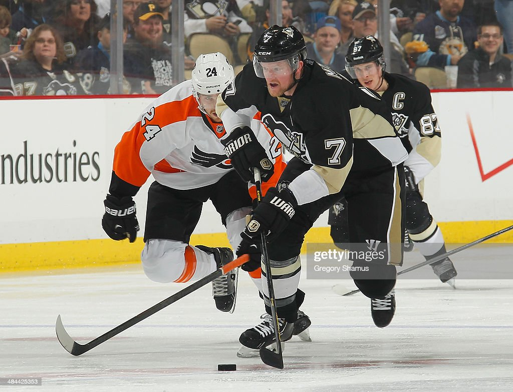 Paul Martin #7 of the Pittsburgh Penguins moves the puck up ice in front of Matt Read #24 of the Philadelphia Flyers on April 12, 2014 at Consol Energy Center in Pittsburgh, Pennsylvania.