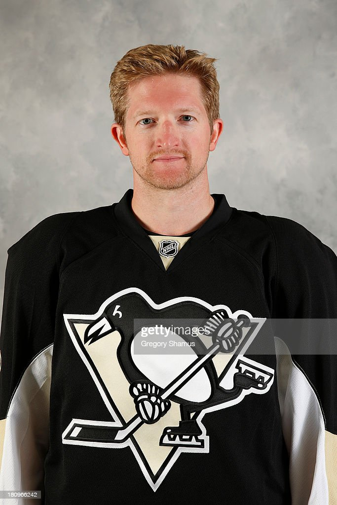 Paul Martin #7 of the Pittsburgh Penguins poses for his official headshot for the 2013-2014 season on September 11, 2013 at the Consol Energy Center in Pittsburgh, Pennsylvania.