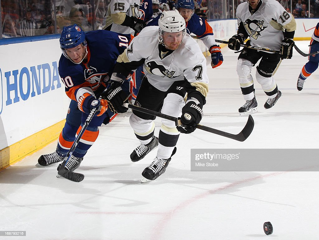 Paul Martin of the Pittsburgh Penguins skates against Keith Aucoin of the New York Islanders in Game Four of the Eastern Conference Quarterfinals...