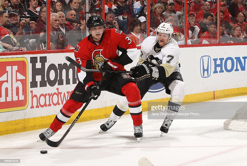 Paul Martin #7 of the Pittsburgh Penguins uses his stick to slow down Jakob Silfverberg #33 of the Ottawa Senators in Game Three of the Eastern Conference Semifinals during the 2013 NHL Stanley Cup Playoffs, at Scotiabank Place, on May 19, 2013 in Ottawa, Ontario, Canada.