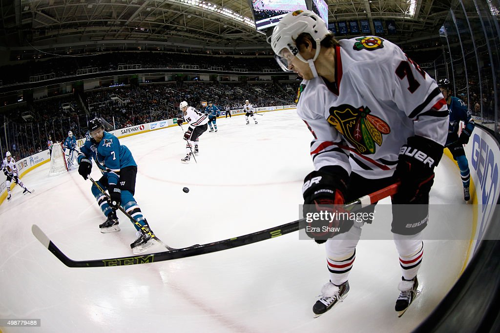 Paul Martin #7 of the San Jose Sharks and Artemi Panarin #72 of the Chicago Blackhawks go for the puck at SAP Center on November 25, 2015 in San Jose, California.